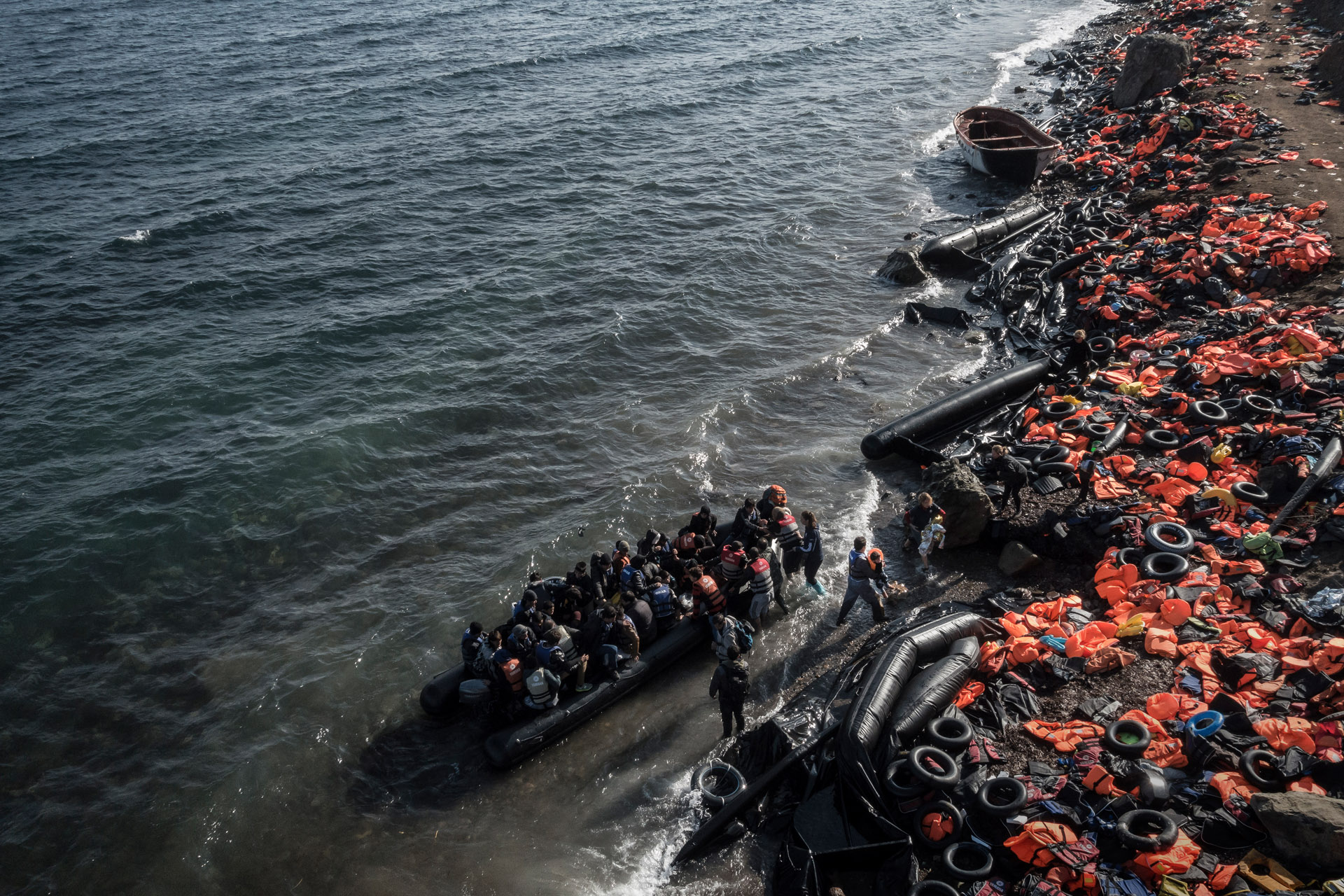 Refugees and migrants arrive on the shore in Greece.