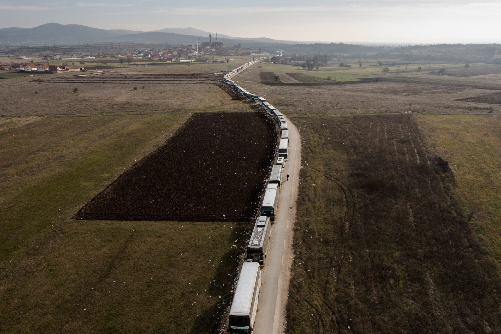 A 4 kilometer bus convoy for refugees.