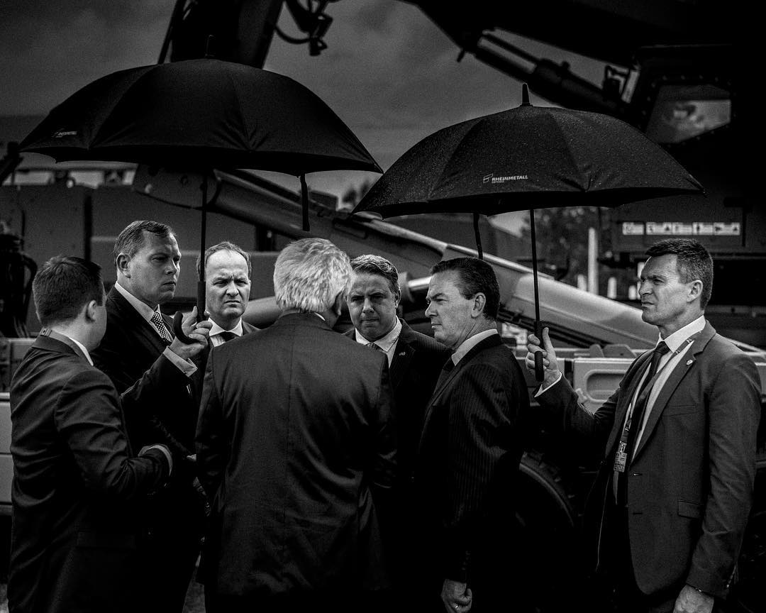 My story WAR FAIR is finally online. Ive worked the last two years visiting defence Industry fairs investigating where and on what all the billions of dollars are being spent while we again head into an international arms race.  In this photo boardmembers of large german arms producer RheinMetall discuss after product launch of their news tank at Eurosatory in Paris #warfair  Story is online on my website – www.rasmusdegnbol.com