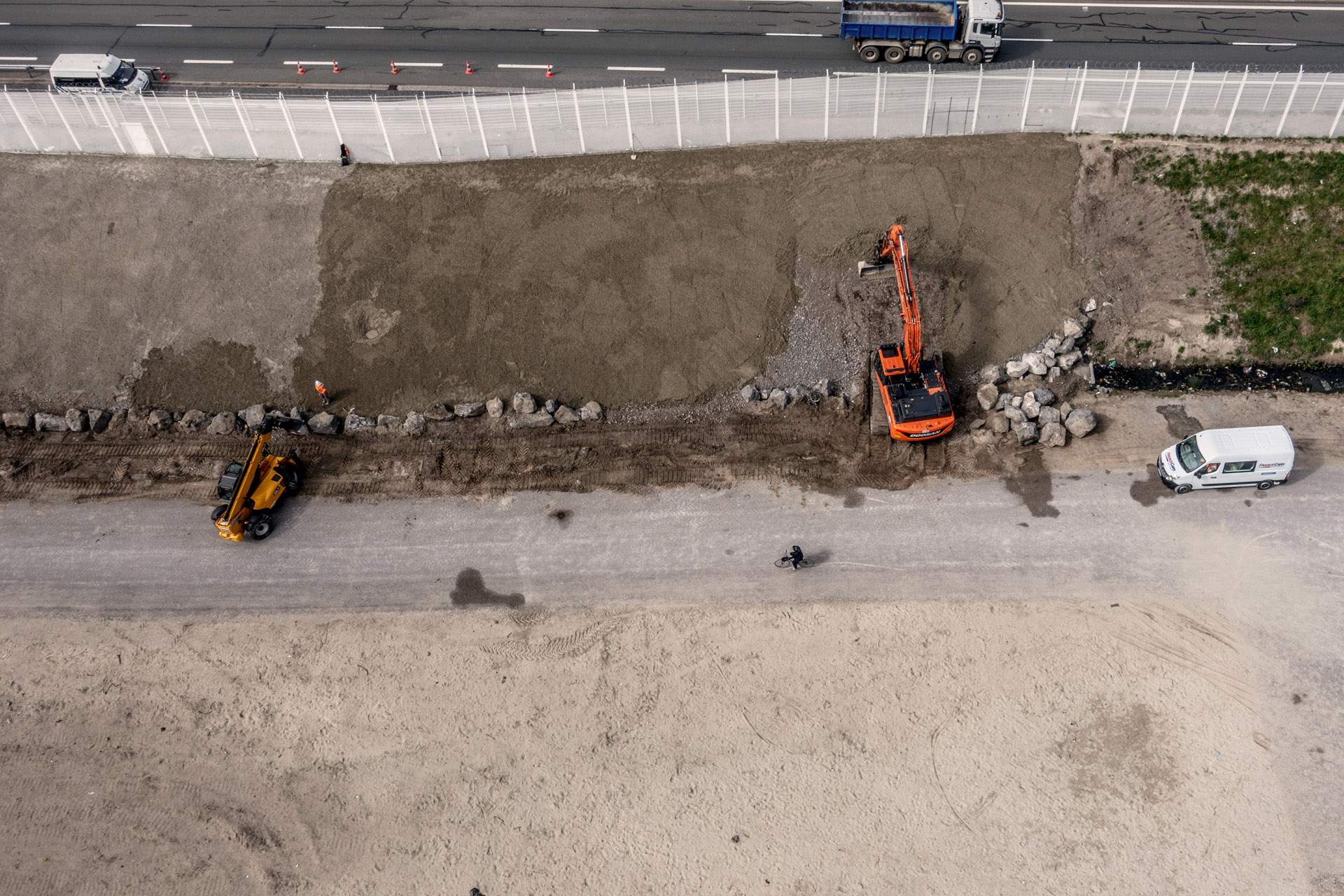 Workers maintain the Calais fence.